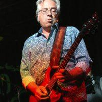 """Dennis Costis plays guitar, """"70s FM,"""" """"The Woodstock Era,"""" """"The Core,"""" and """"Have a Cigar"""""""
