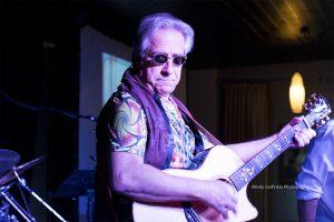 Dennis Costis playing guitar, Woodstock Review
