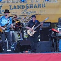 Gary Stratton (vocals & guitar), Tom Cassady (drums), Tom Hamning (bass guitar) and Bill LeClair, (keyboards), the Wall of Denial Steve Ray Vaughan tribute band